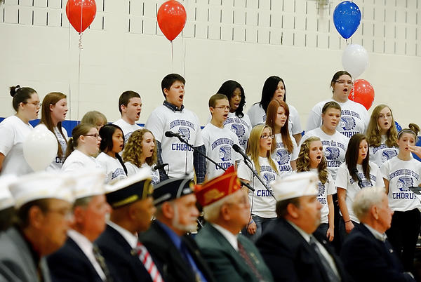 Chorus members sing a patriotic song at a Veterans Day program at Boonsboro High School on Friday.