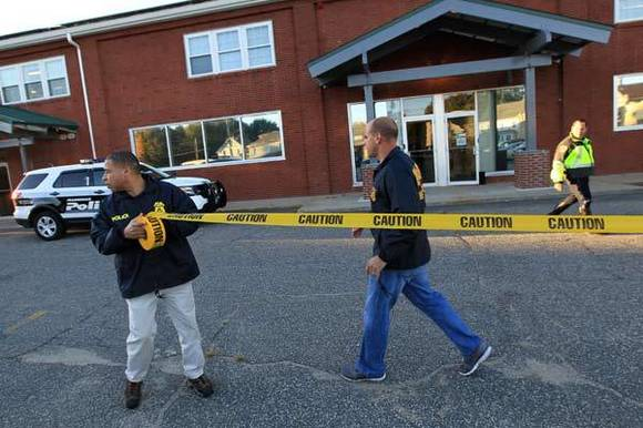 FDA-OCI agents cordon off the New England Compounding Center (NECC) in Framingham, Mass.