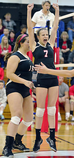 North Hagerstown's Michey Moody (7) celebrates in front of teammate Zoe Schreiber after Moody put away a kill against Linganore in Friday night's Maryland Class 3A West volleyball final.