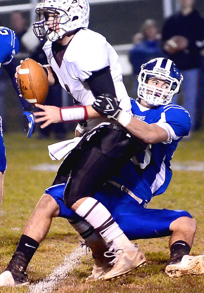 Boonsboro's Tyler Hollis, right, sacks Brunswick quarterback Collin Nusbaum in the first quarter of Friday night's Maryland Class 1A West semifinal at Boonsboro.