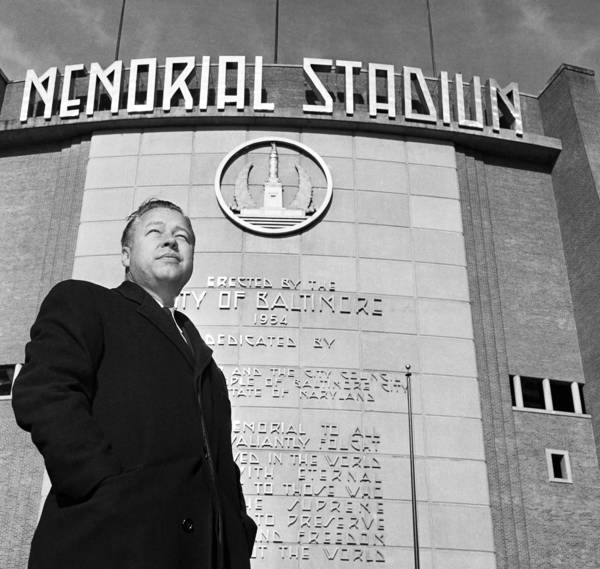 Lee MacPhail stands in front of Baltimore's Memorial Stadium in this photograph from Dec. 11, 1959. MacPhail, who died Thursday at the age of 95, was president and general manager of the New York Yankees and general manager of the Baltimore Orioles before serving as president of the American League from 1974 to 1983.