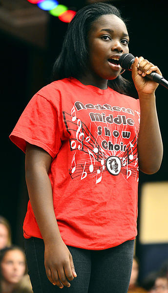 "Northern Middle School student Jazmin Techie-Mensah sings ""God Bless America"" during a Veteran's Day Celebration at the school Friday."