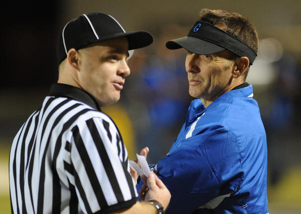 Palm Beach Gardens High head football coach Rob Freeman talks to one of the referees during halftime of th egame against Lake Worth High.