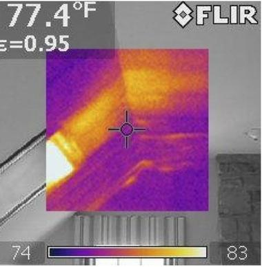 Purple shading on infrared photo shows area without insulation in home's attic.