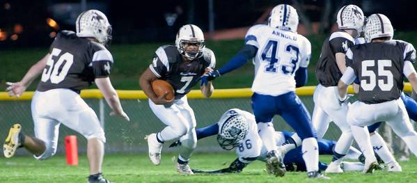Catasauqua running back Ra'Von Burton (7) looks for an opening in the line as Northern Lehigh's Caleb Johnson (86) misses the tackle and teammate Austin Arnold (43) positions to tackle in the first quarter of their District 11 first round playoff game at Catasauqua High School stadium on Friday night.