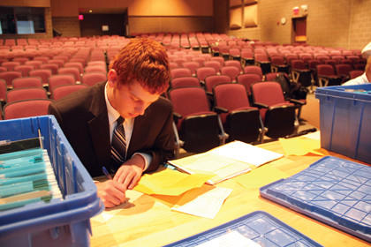 Isaac Frederick, a sophomore at Aberdeen Central High School, prepares Friday for the domestic extemporaneous speaking competition.