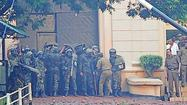 Sri Lanka's Special Task Force soldiers block the entrance to Welikada prison during a clash with prisoners in Colombo