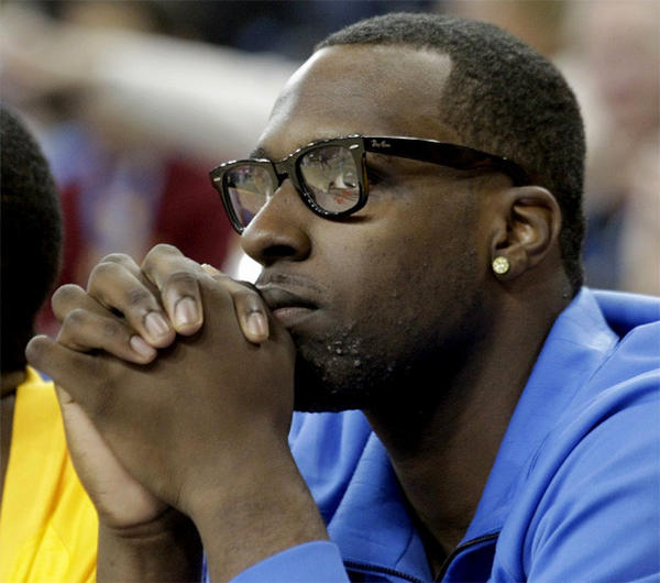 Bruins' top recruit Shabazz Muhammad watches the season-opening game against Indiana State from UCLA's bench.