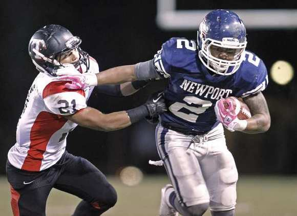Newport Harbor High's Talalelei Teaupa (2) rushed for 272 yards and two touchdowns on 26 carries against Troy.