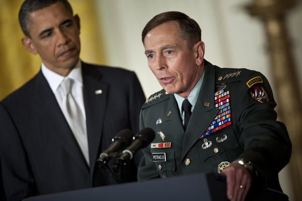 President Barack Obama (L) listens while his nominee for Director of the Central Intelligence Agency (CIA), Army Gen. David Petraeus, speaks in the East Room of the White House April 28, 2011 in Washington, D.C. President Obama announced he is nominating Director of the CIA Leon Panetta as Secretary of Defense, commander for International Security Assistance Force (ISAF) and U.S. forces in Afghanistan Gen. David Petraeus as Director of the CIA, Ryan Crocker as U.S. ambassador to Afghanistan and Gen. John Allen as commander for ISAF and U.S. forces in Afghanistan.