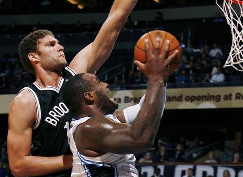 "Orlando forward Glen ""Big Baby"" Davis struggles under the defense of Brooklyn center Brook Lopez during the Brooklyn Nets at Orlando Magic NBA game at the Amway Center on Friday, November 9, 2012."