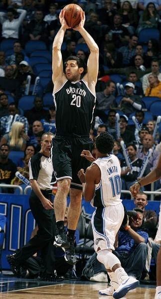 Brooklyn forward Tomike Shengelia (20) leaps high for a pass over Orlando guard Ish Smith (10) during the Brooklyn Nets at Orlando Magic NBA game at the Amway Center on Friday, November 9, 2012.
