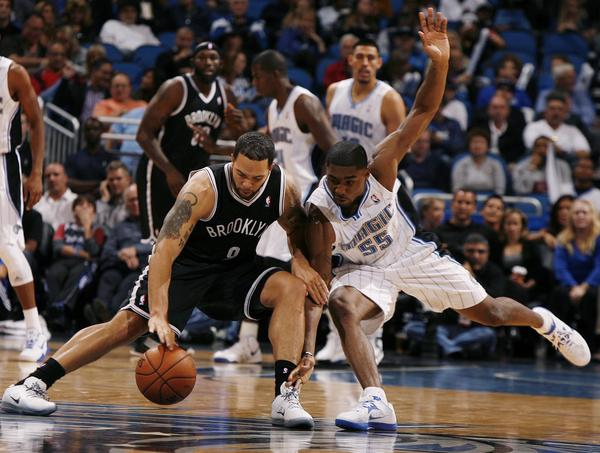 Orlando guard E'Twaun Moore (55) and Brooklyn guard Deron Williams (8) battle for the ball during the Brooklyn Nets at Orlando Magic NBA game at the Amway Center on Friday, November 9, 2012.