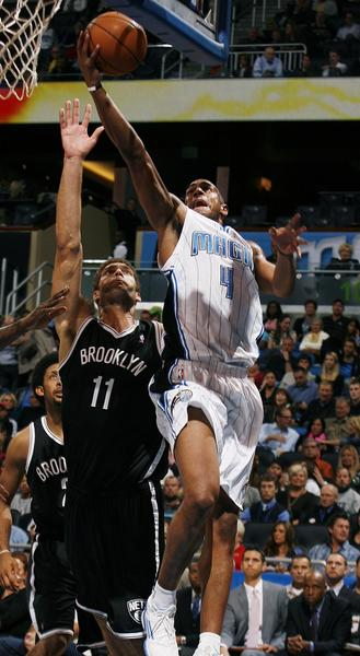 Orlando guard Arron Afflalo (4) scores over Brooklyn center Brook Lopez (11) during the Brooklyn Nets at Orlando Magic NBA game at the Amway Center on Friday, November 9, 2012.