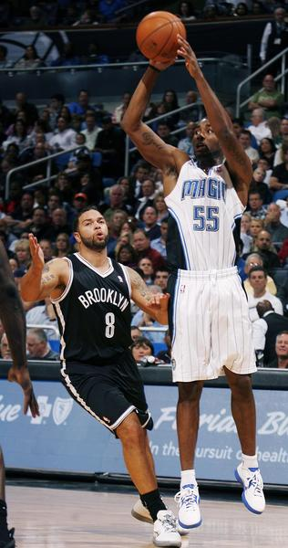 Orlando guard E'Twaun Moore (55) shoots over Brooklyn guard Deron Williams (8) during the Brooklyn Nets at Orlando Magic NBA game at the Amway Center on Friday, November 9, 2012.