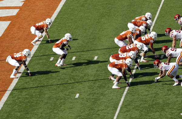 Texas lines up in the wishbone formation to run its first play from scrimmage against Iowa State on Saturday in honor of former coach Darrell Royal.