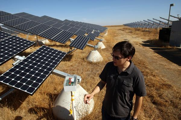 Varick Erickson, UC Merced campus energy manager and graduate student, views a solar radiance node for short-term forecasting of solar power production at the UC Merced solar field.