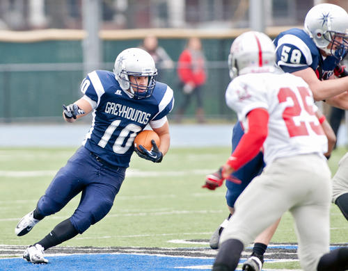 Moravian's C.J. Billera runs upfield pursued by Muhlenberg's Jeremy Thomas (25) in the first quarter of their game at Moravian College's Steel Field stadium on Saturday afternoon.