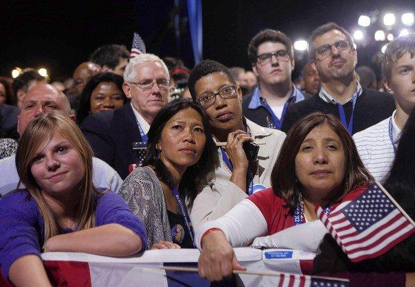 Supporters of President Obama watch him celebrate his reelection at his election night rally in Chicago.
