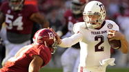 Johnny Manziel had 343 yard of total offense and two touchdowns and Texas A&M picked off A.J. McCarron on fourth-and-goal to seal the Aggies¿ 29-24 victory over No. 1 Alabama.