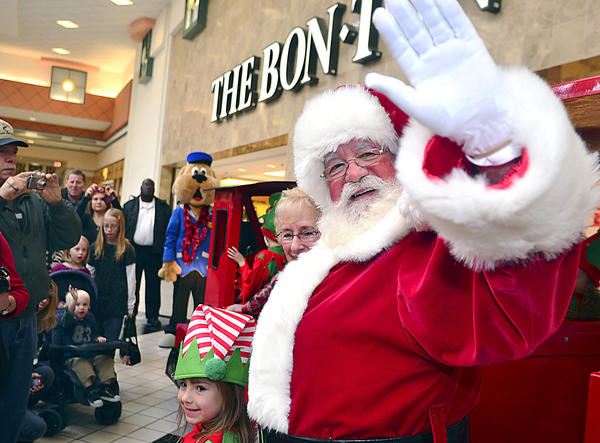 Santa Claus waves to all the boys and girls with their families and friends upon his arrival at the Valley Mall in Hagerstown Saturday.
