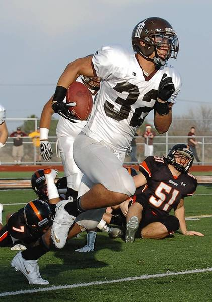 Joliet Catholic's Ty Isaac breaks away for his second touchdown of the day.