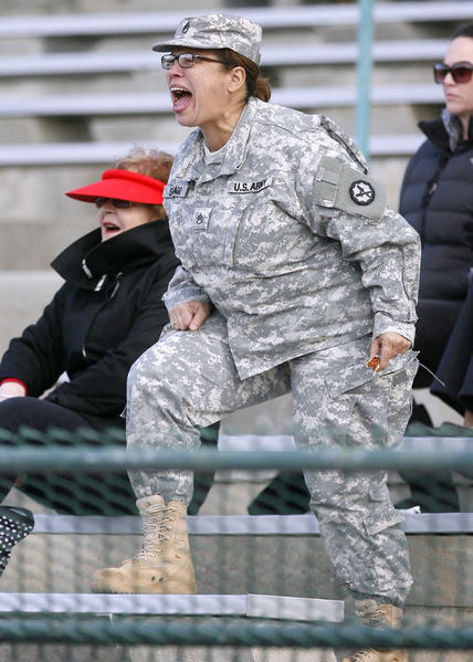 Piere College football player's mom SSgt. Carmen Santiago cheers for her son during Glendale College Football game vs. Pierce College in Glendale on Saturday, Nov. 10, 2012.
