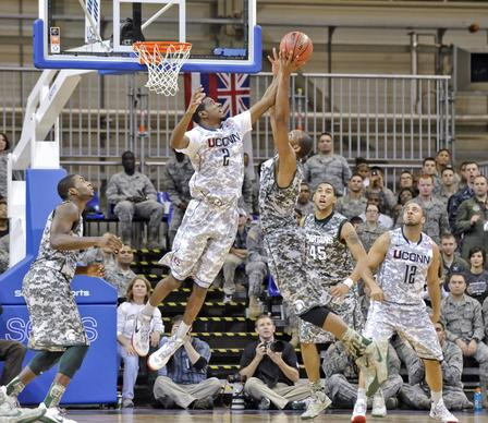 Connecticut Huskies DeAndre Daniel (2) blocks a shot by Michigan State's Branden Dawson during the game at Ramstein Air Base.