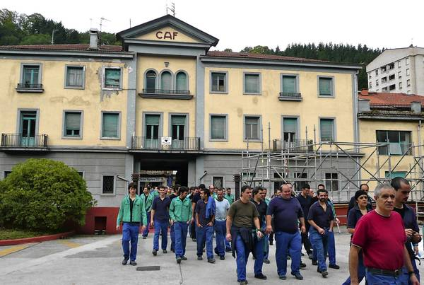 Workers file through the entrance to the CAF headquarters in Beasain, Spain, last month. More than three-quarters of CAF's sales are abroad, unfettered by Spain's economic crisis, and the company has posted operating profits of 10% or more for the last five years.
