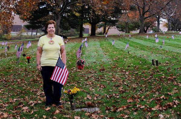 Gold Star Mom Carol Resh, of Fogelsville, mother of CPT. Mark Resh, a soldier who was killed in Iraq, leads an effort to lay wreaths at every veteran's grave in Cedar Hill cemetery as part of Wreaths Across America.