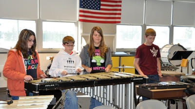 Percussionists Lauren Basinger, Nathan Brant, Shayla Howard and Michael Alvares participate in band practice.
