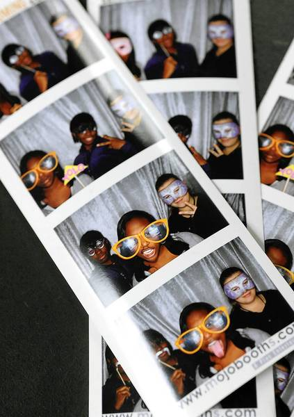A photo strip of Lacey Hailey 15, of Allentown (center) shows her striking a pose with her friends in a Mojobooth, a 10-person photo booth for any occasion during an after school program for students called Strive, Inc., held at Lehigh University Thursday afternoon.