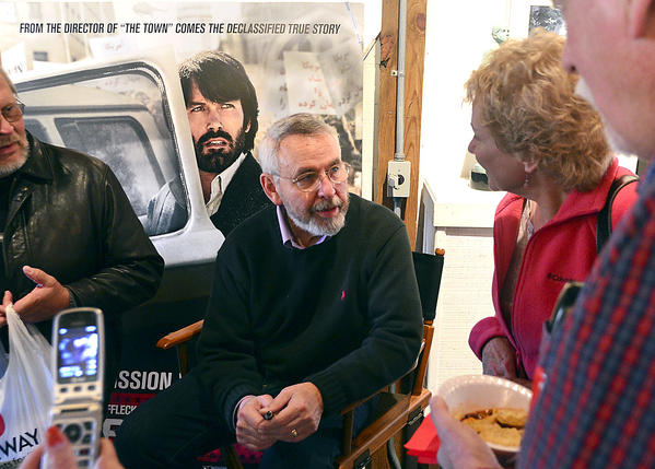 Antonio Mendez, center, signs copies of his latest book Argo, a companion to the movie of the same name starring Ben Affleck, who portrays Mendez in the film. The Mendez family art studio, Pleasant Valley Studios, hosted a Fall Art Show Saturday in Knoxville. The show continues on Sunday.