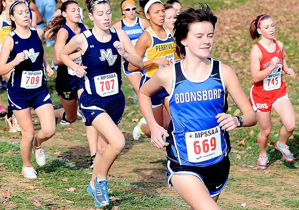 Boonsboro senior Sarah Zielinski leads the pack early in the Class 1A girls race en route to the state title at the Maryland State Cross Country Championships on Saturday at Hereford High School. Zielinski helped the Warriors win the team title.