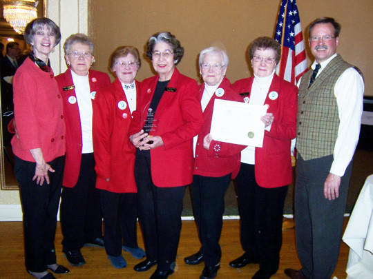 On Oct. 13, Aberdeen's WWII Pheasant Canteen team was honored at an award ceremony and reception at the Ward Hotel. The group received two national history awards ¿ the Award of Merit and the History in Progress Award ¿ from the American Association of State and Local History for the team's efforts in collecting and exhibiting artifacts and stories related to Aberdeen's famed WWII Red Cross Canteen, which became known as the Pheasant Canteen because of its main menu item ¿ the pheasant sandwich. From left are: Sue Gates, Dacotah Prairie Museum director and AASLH state chair; canteen team members Lila Schwalbe, Merilee Frankenberger, Vera Lilly, Ruth Casanova, and Patsy Weigel; Jay Vogt, South Dakota State Historical Society director and regional AASLH representative.