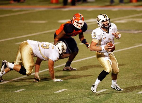 UCF Knights quarterback back Blake Bortles (5) scrambles against the UTEP Miners defense during the first half at Sun Bowl stadium.