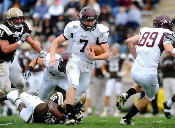 Colgate's QB Gavin McCarney (center) looks for room to run against the Lehigh defense during their Patriot League Championship football game Saturday November 10, 2012.
