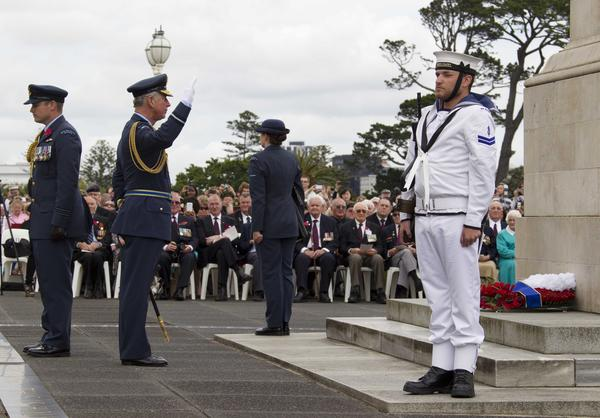 Britain's Prince Charles (2nd-L) salute after laying a wreath during the Armistice Day Commemoration service at the Auckland War Memorial Museum on November 11, 2012.  The royal couple arrived in New Zealand on the last leg of their tour marking Queen Elizabeth II's diamond jubilee.
