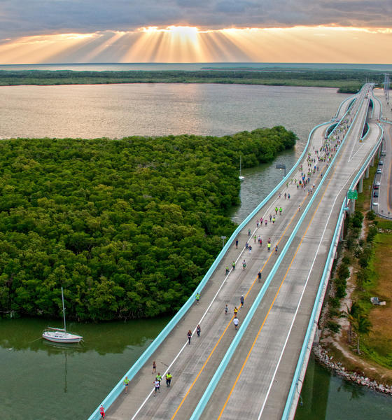 In this image released by the Florida Keys News Bureau, runners in the Key Largo Bridge Run reach the apex of the Jewfish Creek Bridge on the Florida Keys Overseas Highway on November 10, 2012, in Key Largo, Florida. The event attracted 885 participants who competed in half-marathon, 5k and 10k divisions.