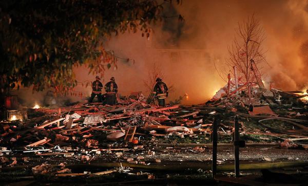 A massive explosion was reported Saturday night at a residence off Stop 11 Road and Sherman Drive. (Matt Kryger/The Indianapolis Star)