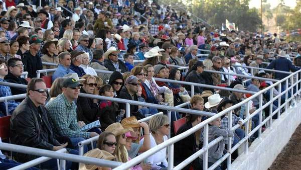 Cattle Call Rodeo fans fill the box seats Saturday afternoon at Cattle Call Arena in Brawley.