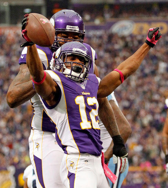 Minnesota Vikings wide receiver Percy Harvin celebrates after he scores a touchdown on a four-yard run during the first half of their NFL football game against the Tennesee Titans in Minneapolis, October 7, 2012.
