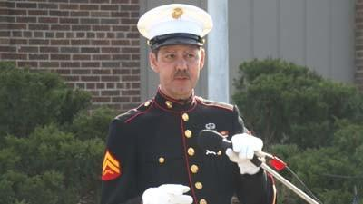 "Harbor Springs resident Ron Pearsall, who served in the U.S. Marine Corps from 1975-81, speaks during a Veterans Day program today in Pennsylvania Park. Pearsall suggested sending care packages as a way to support current personnel. ""It means the world to them,"" he said."