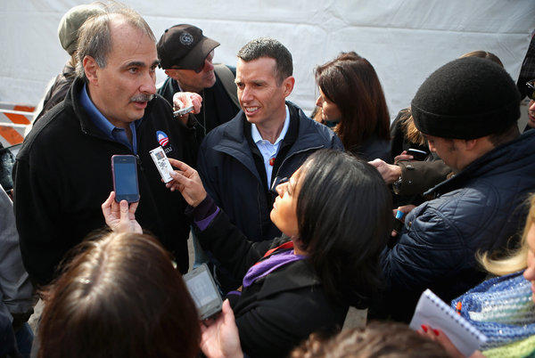 Obama campaign chief strategist David Axelrod, left, and Senior Advisor to the President David Plouffe talk with reporters during the last day of campaigning.