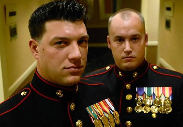 Sgt. Dan Ledogar, left, of Pomfret, helped save the life of Sgt. Greg Caron, right, in Afghanistan after a roadside bomb exploded, severing Caron's legs at the knees. The two met six years ago and were later deployed to Iraq, then Afghanistant.