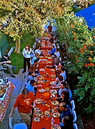 "Friends gather at the ""Long Table Thanksgiving,"" which has grown over the years."