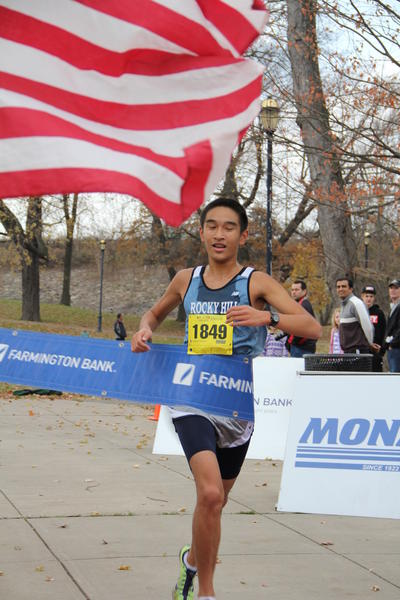 Alex Tan, 16, of Rocky Hill, takes first in the Freedom Run 5K Sunday with a time of 17 minutes and 38 seconds.