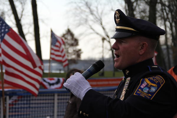 Lieutenant Kevin McCarthy, of the West Hartford Police Dept. sings the National Anthem prior to the start of the Freedom Run 5K at Riverside Park in Hartford Sunday, Nov. 11.