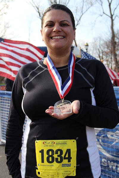 Jodi Chouinard, of Vernon, won first place in the women's U.S. Air Force division at the Freedom Run 5K held at Riverside Park in Hartford Sunday. Chouinard is a veteran of the U.S. Air Force.