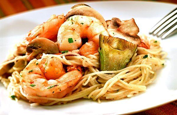 Pasta is tossed with plump shrimp and artichokes.